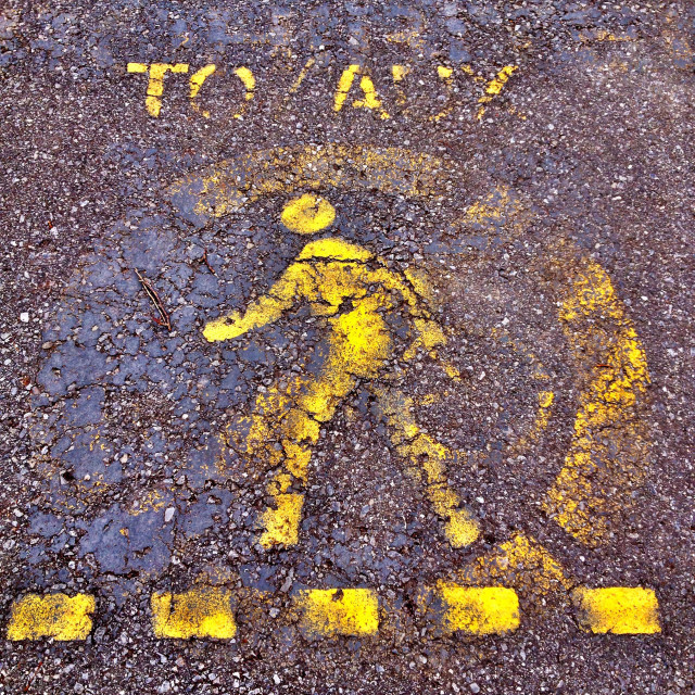 """English And French Sign To Give Way To Pedestrians Painted On A Pavement For Cyclists To Obey."" stock image"