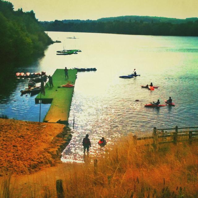 """Canoeists paddling in a lake, Surrey, UK"" stock image"
