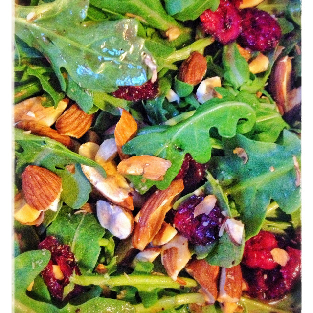 """""""Arugula salad with cranberries and almonds"""" stock image"""