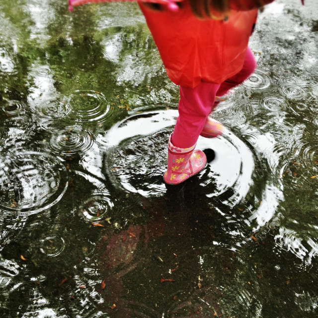 """""""Child in red walking in the rain"""" stock image"""