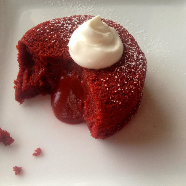 """""""Red velvet cupcake topped with cream"""" stock image"""