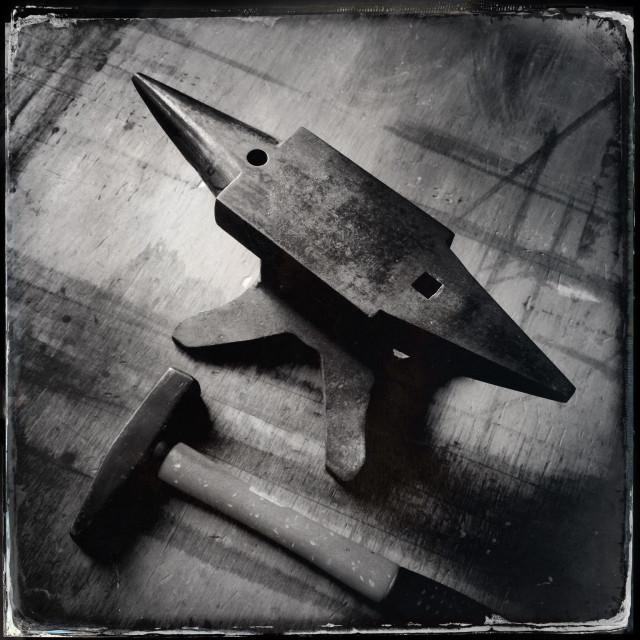 """hammer and anvil blacksmith"" stock image"