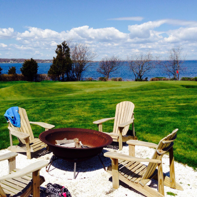 """""""Firepit and Adirondack chairs on Narragansett Bay"""" stock image"""
