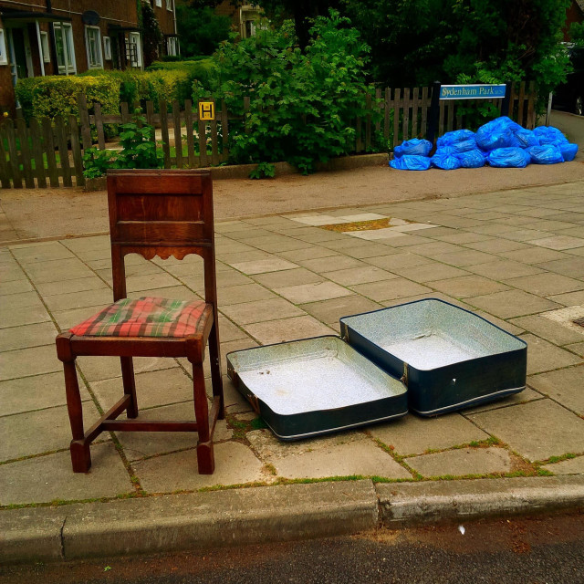 """Abandoned chair and empty suitcase on a London street."" stock image"
