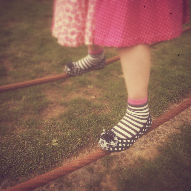 """""""Young girl's feet balancing on tightropes."""" stock image"""