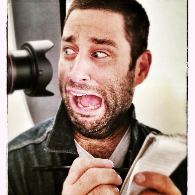 """Camera shy guy"" stock image"