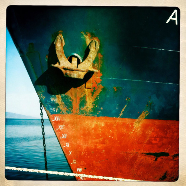 """""""Hull of a Greek freighter at anchor in a harbor"""" stock image"""
