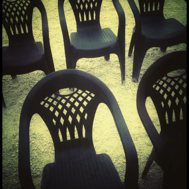 """""""Rows of plastic chairs."""" stock image"""