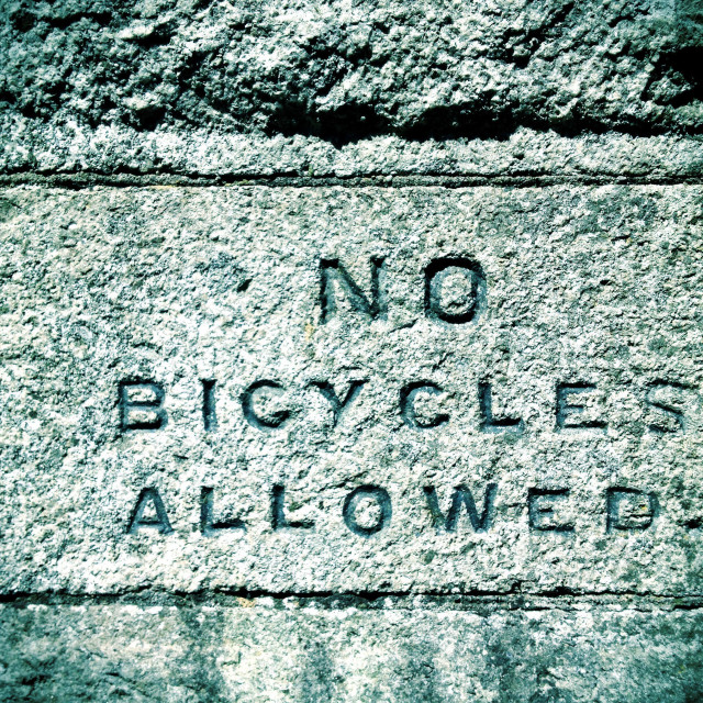 """No bicycles allowed sign in stone."" stock image"