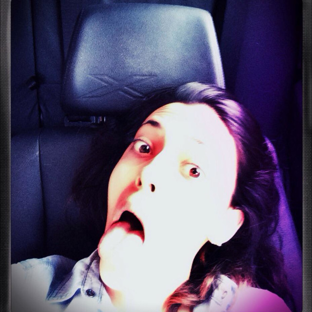 """Frightened young woman in a car"" stock image"