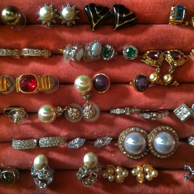 """A large tray of fancy earrings"" stock image"