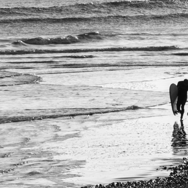 """""""Sidmouth Beach Surfers"""" stock image"""
