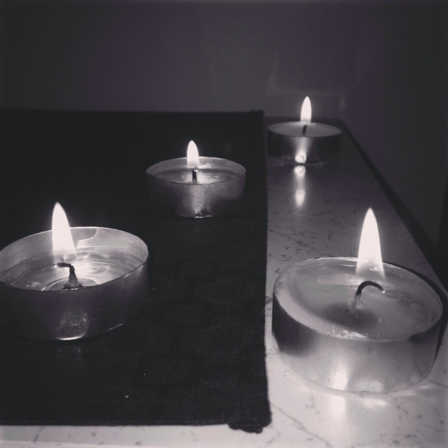 """Candles in the dark"" stock image"