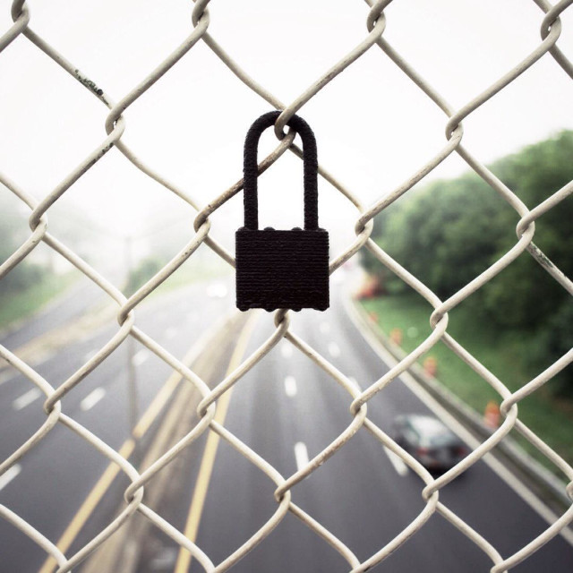 """Lock attached to a fence over the Prospect expressway, Brooklyn, NY"" stock image"