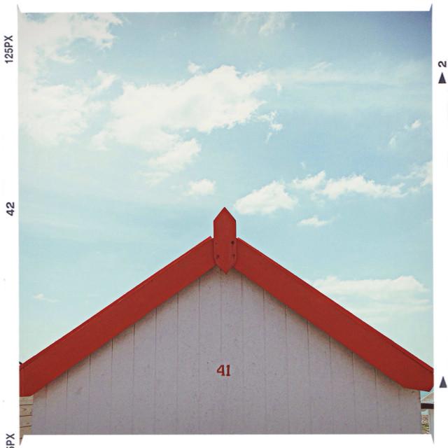 """Orange beachhut against a blue sky"" stock image"