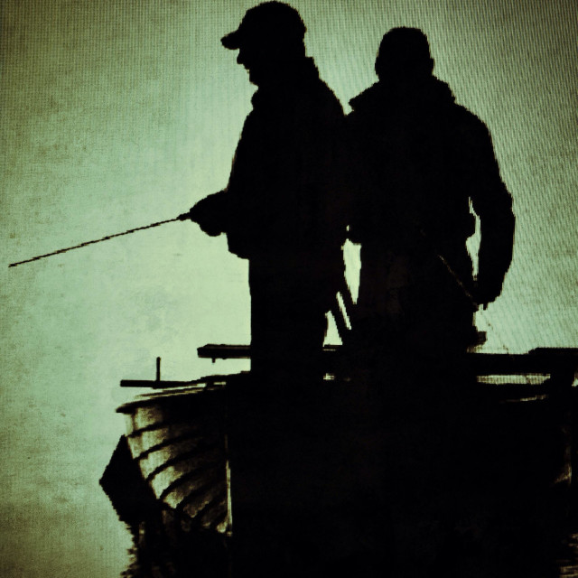 """Two fishermen in the evening gloom"" stock image"