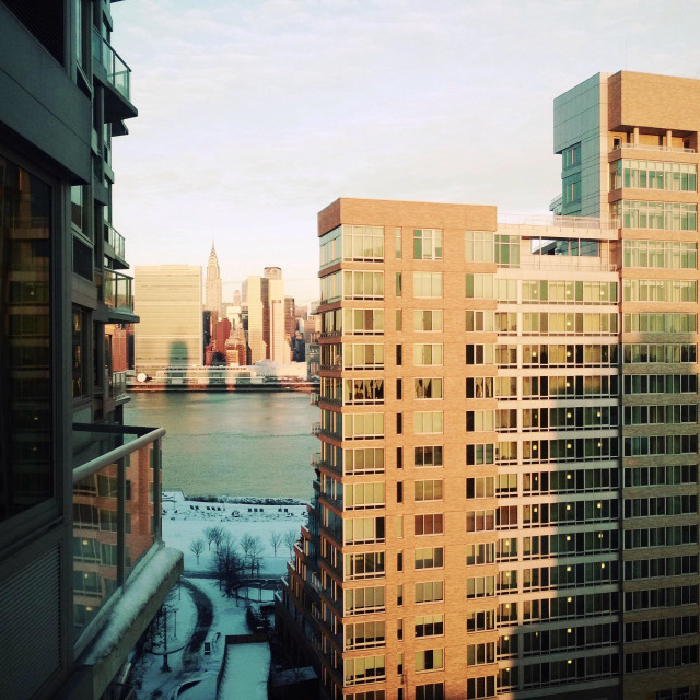 """""""East River and UN headquarters in Manhattan, and in the foreground, condo The View in Long Island City"""" stock image"""