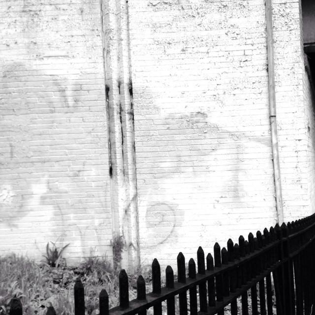 """Brick Wall with Graffiti, Highway Overpass, Brooklyn, New York"" stock image"
