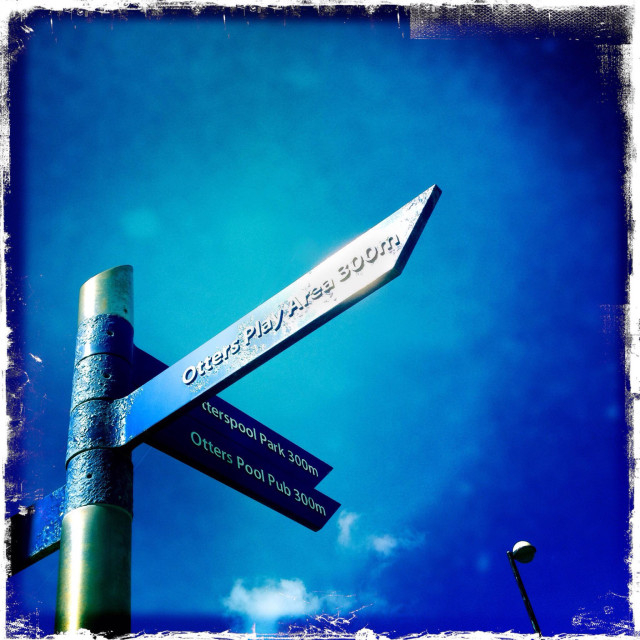 """""""Place direction sign Otterspool Liverpool. Bright blue sky."""" stock image"""