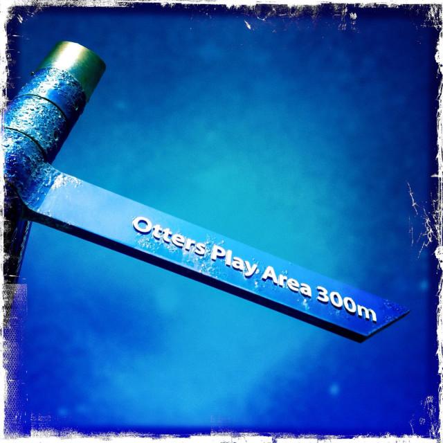 """Otterspool parkland sign post Liverpool. Blue skies. Hipstamatic."" stock image"