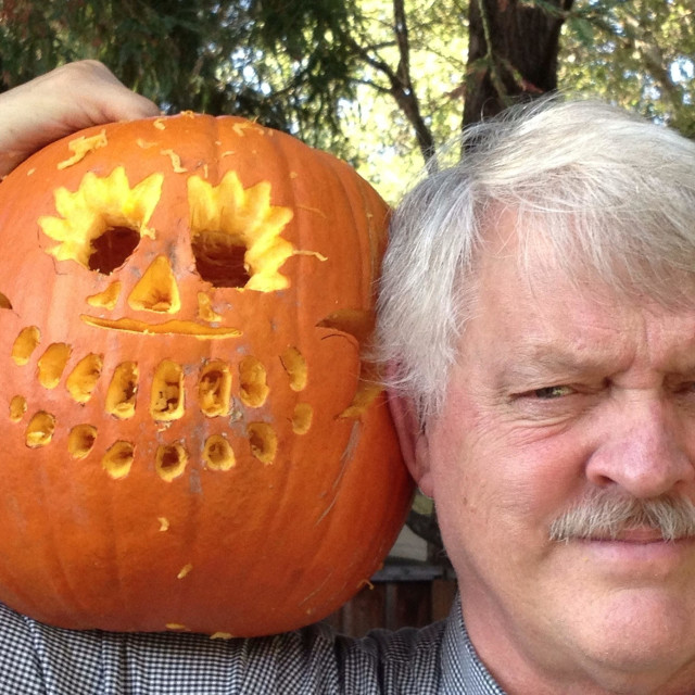 """""""Man with carved pumpkin for Halloween"""" stock image"""