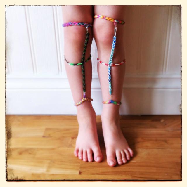 """Loom bands leggings on a kids legs"" stock image"