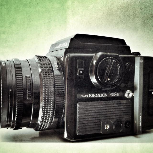 """Vintage Medium format camera on an empty white shelf."" stock image"