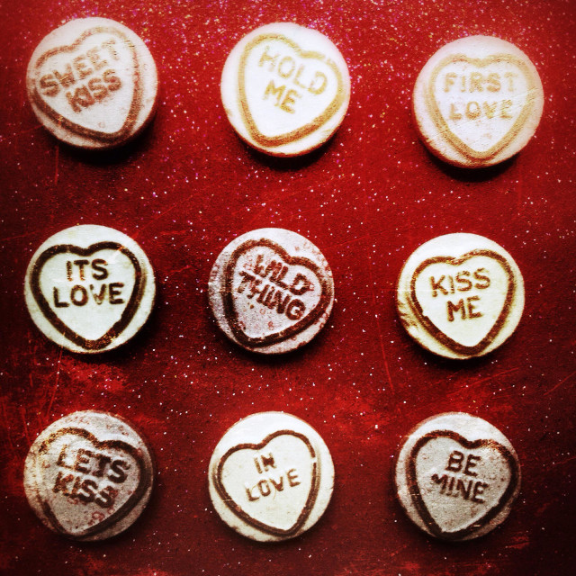 """""""Love heart candy sweets with a selection of slogans"""" stock image"""