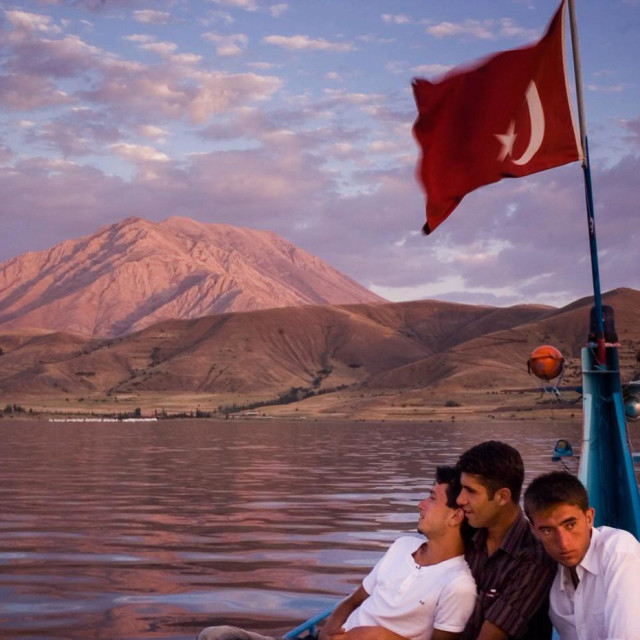 """Young Kurdish men in boating Van Lake in Turkey."" stock image"