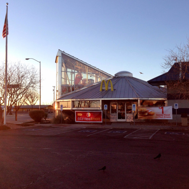 """""""The McDonald's restaurant shaped to resemble a UFO, in Roswell, New Mexico, USA at daybreak."""" stock image"""