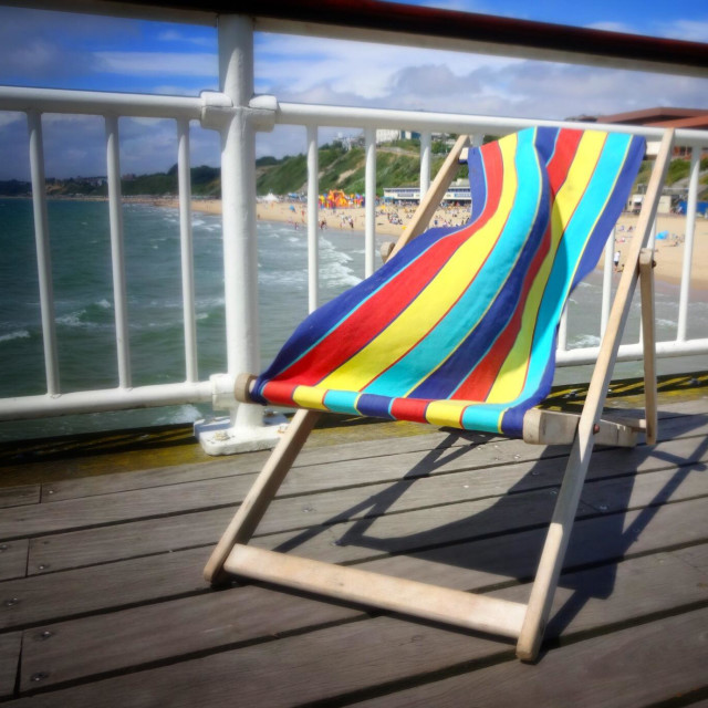 """""""Stripy deck chair blowing in the wind on a blurred background"""" stock image"""