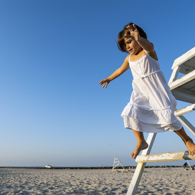 """""""Girl jumping from a lifeguard stand."""" stock image"""