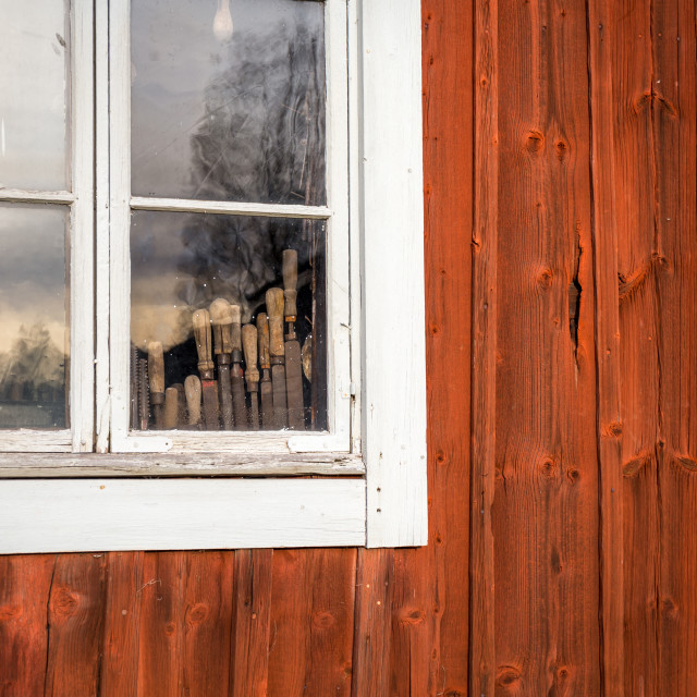 """Vintage tools in cabin window"" stock image"