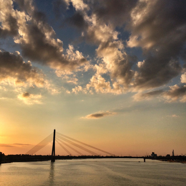 """Vanšu tilts (suspension bridge) over daugava river, Riga, Latvia at sunset"" stock image"