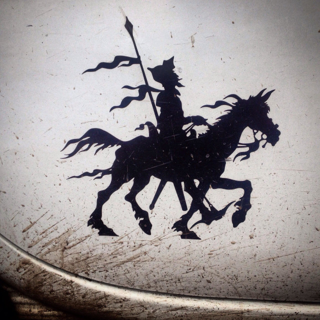 """A sticker of Don Quixote riding his horse Rocinante decorates a truck covered with mud in Mexico City, Mexico"" stock image"