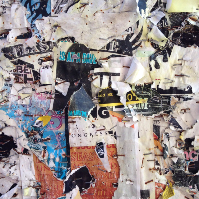 """Paper collage on the wall in Cambridge Ma"" stock image"