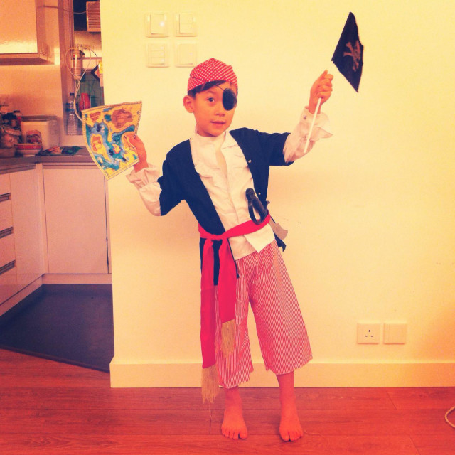 """It's a photo of a young child who wears a pirate costum or uniform for a party"" stock image"