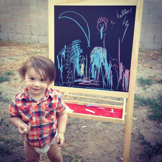 """""""Little boy with easel"""" stock image"""