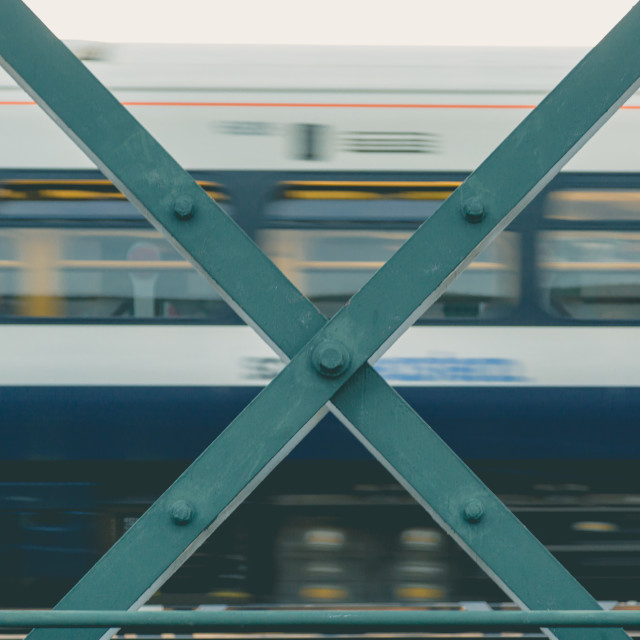 """""""Waterloo bridge cross construction with motion blurred train tow"""" stock image"""