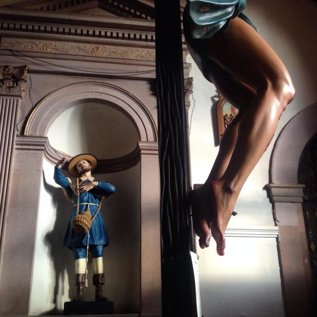 """""""The legs of a crucified Jesus Christ and a saint in Our Lady of Guadalupe congregation in Queretaro, Mexico."""" stock image"""