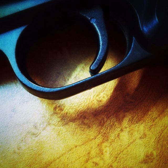 """Trigger of 9mm automatic handgun."" stock image"
