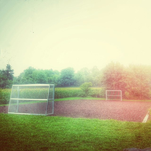 """Rural small football ground (Retro postprocessing)"" stock image"