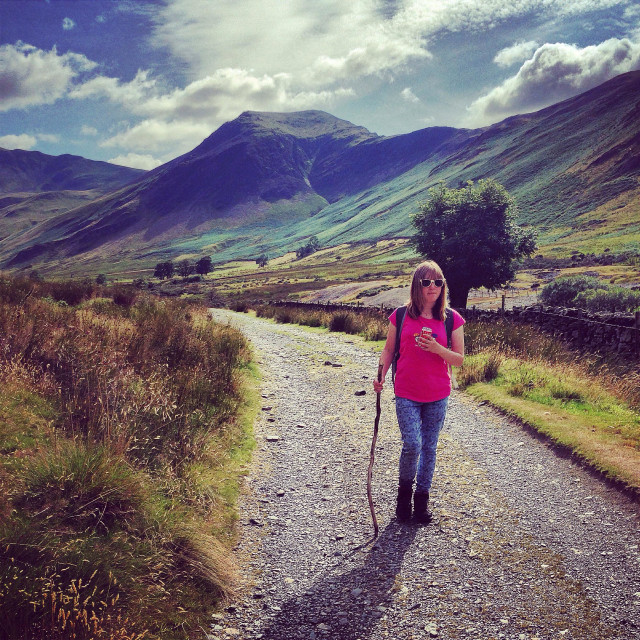 """""""A teenager walking in the Newlands valley in the Lake District"""" stock image"""