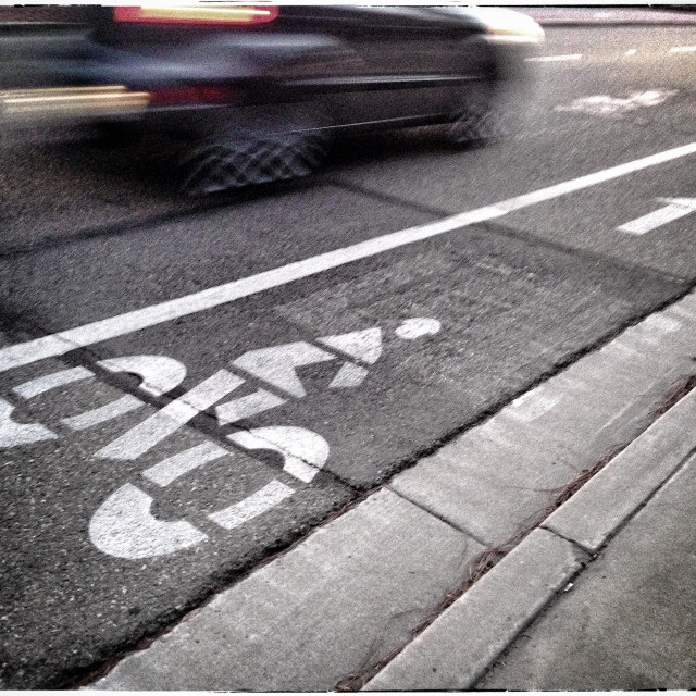 """""""Bicycle Lane With Speeding Car Zooming By"""" stock image"""