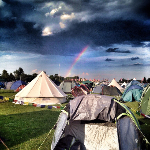 """A rainbow over the campsite at WOMAD music festival"" stock image"