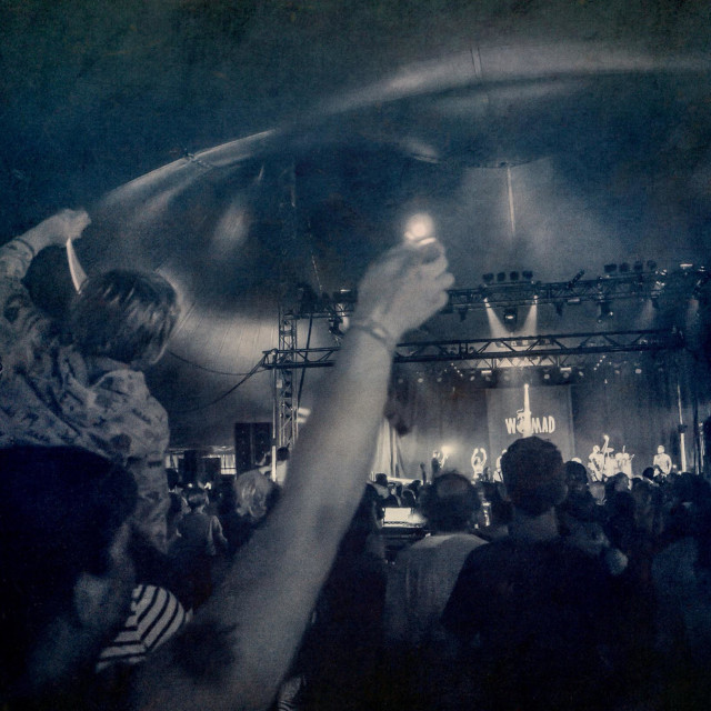 """Crowd watch ""Jus' Now"" performing at WOMAD festival 2014"" stock image"