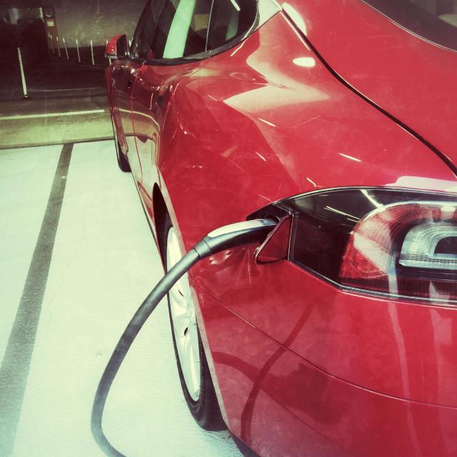 """Red Tesla Model S car recharging"" stock image"