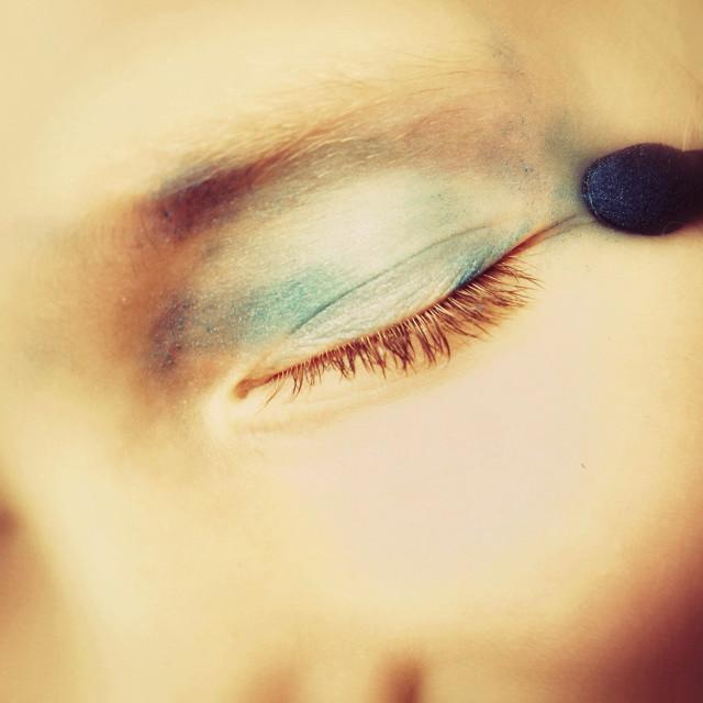 """""""Young girl applying make up"""" stock image"""