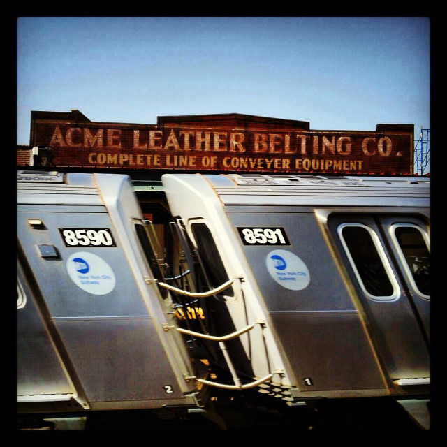 """""""The bending train -J train in Brooklyn at the Lorimer station"""" stock image"""