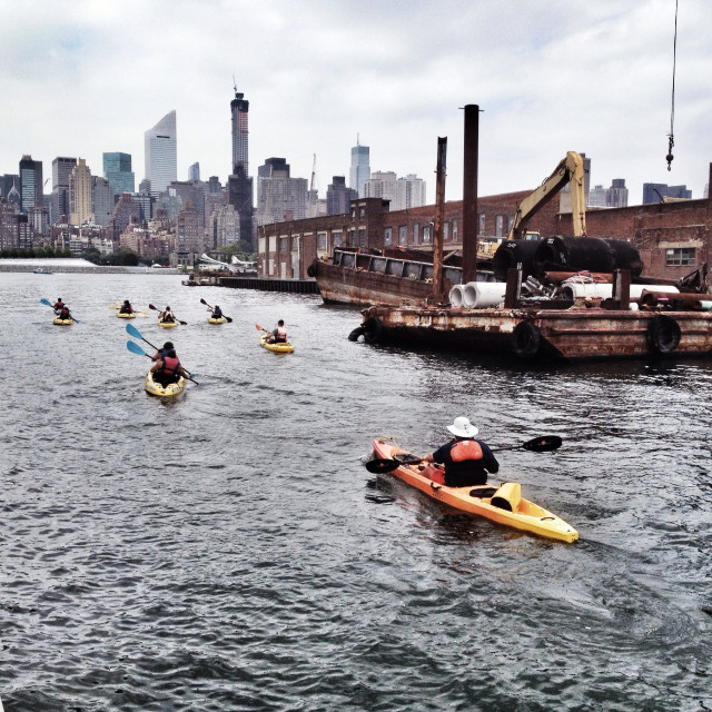 """""""Kayaks paddling to the East river in Long Island City, Queens"""" stock image"""